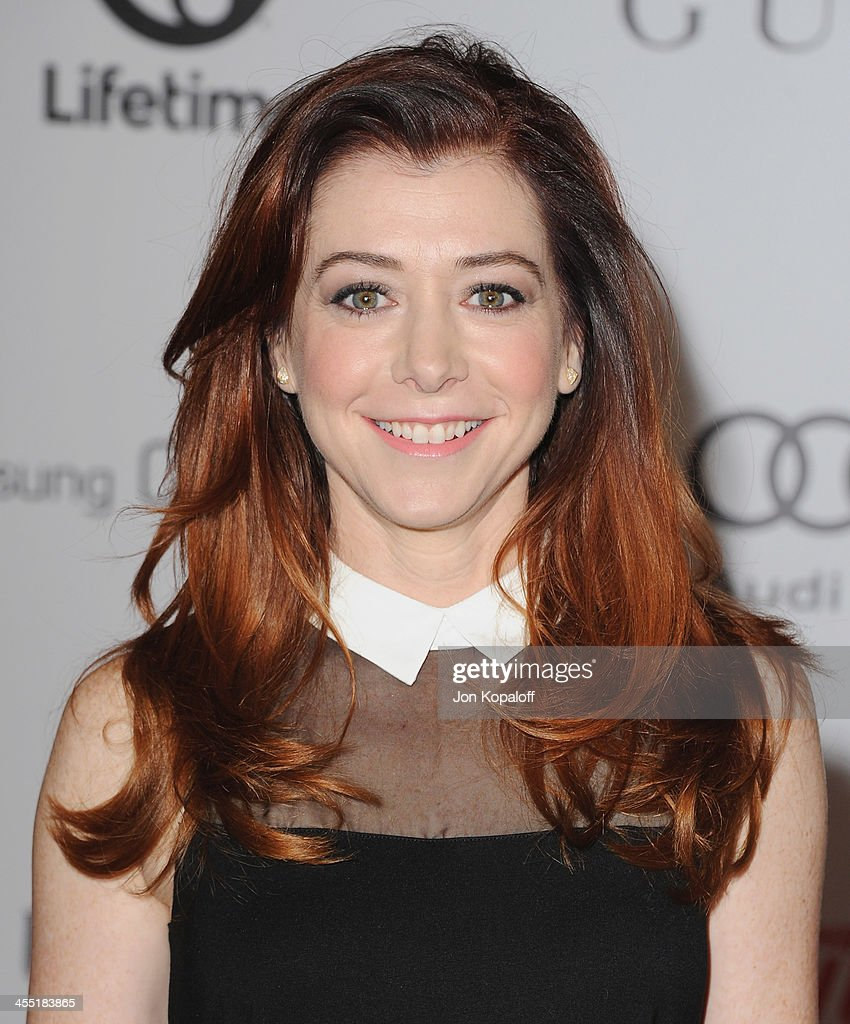 Actress Alyson Hannigan arrives at The Hollywood Reporter's 22nd Annual Women In Entertainment Breakfast 2013 at Beverly Hills Hotel on December 11, 2013 in Beverly Hills, California.