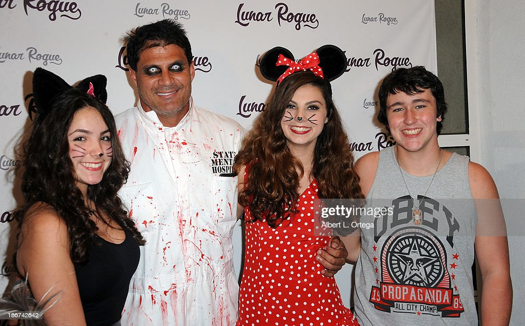 Actress Alyssa Esposito, athlete Jose Canseco, actress Taylor Hay and actor Noah Dahl arrive for the CD Release And Halloween Costume Party For Lunar Rogue on October 26, 2013 in Beverly Hills, California.
