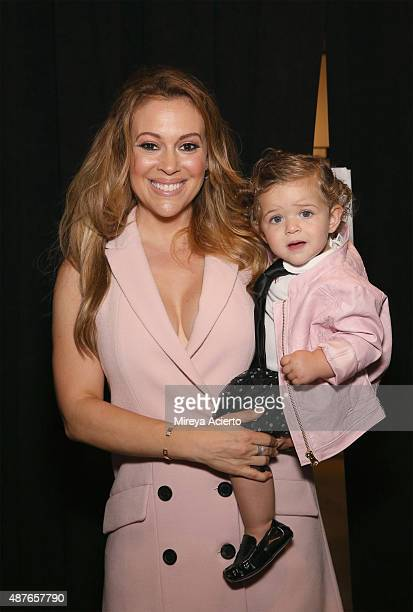 Actress Alyssa Milano and daughter Elizabella Milano pose backstage before the Marissa Webb fashion during Spring 2016 MADE Fashion Week at Milk...