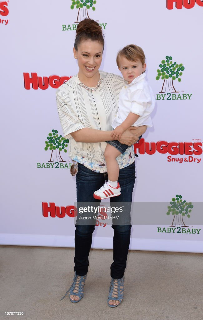Actress <a gi-track='captionPersonalityLinkClicked' href=/galleries/search?phrase=Alyssa+Milano&family=editorial&specificpeople=203329 ng-click='$event.stopPropagation()'>Alyssa Milano</a> and her son Milo attend the Huggies Snug & Dry and Baby2Baby Mother's Day Garden Party held on April 27, 2013 in Los Angeles, California.