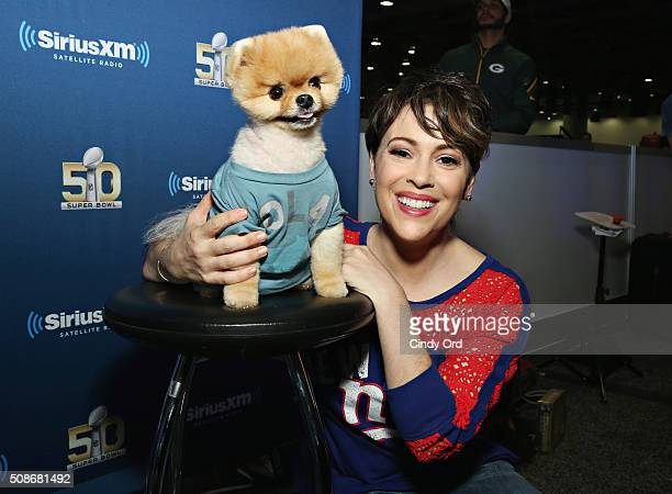 Actress Alyssa Milano and Jiffpom visit the SiriusXM set at Super Bowl 50 Radio Row at the Moscone Center on February 5 2016 in San Francisco...