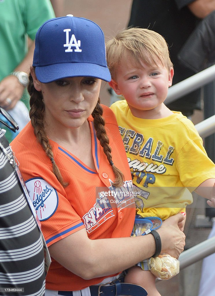 Actress <a gi-track='captionPersonalityLinkClicked' href=/galleries/search?phrase=Alyssa+Milano&family=editorial&specificpeople=203329 ng-click='$event.stopPropagation()'>Alyssa Milano</a> (L) and son Milo Thomas Bugliari attend the Taco Bell All-Star Legends & Celebrity Softball Game at Citi Field on July 14, 2013 in New York City.