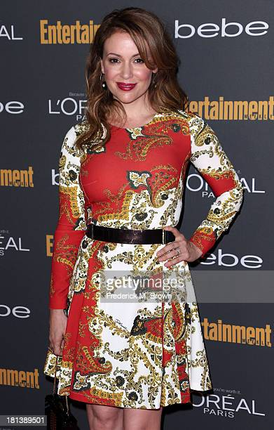 Actress Alyssa Milano arrives at Entertainment Weekly's PreEmmy Party at Fig Olive Melrose Place on September 20 2013 in West Hollywood California
