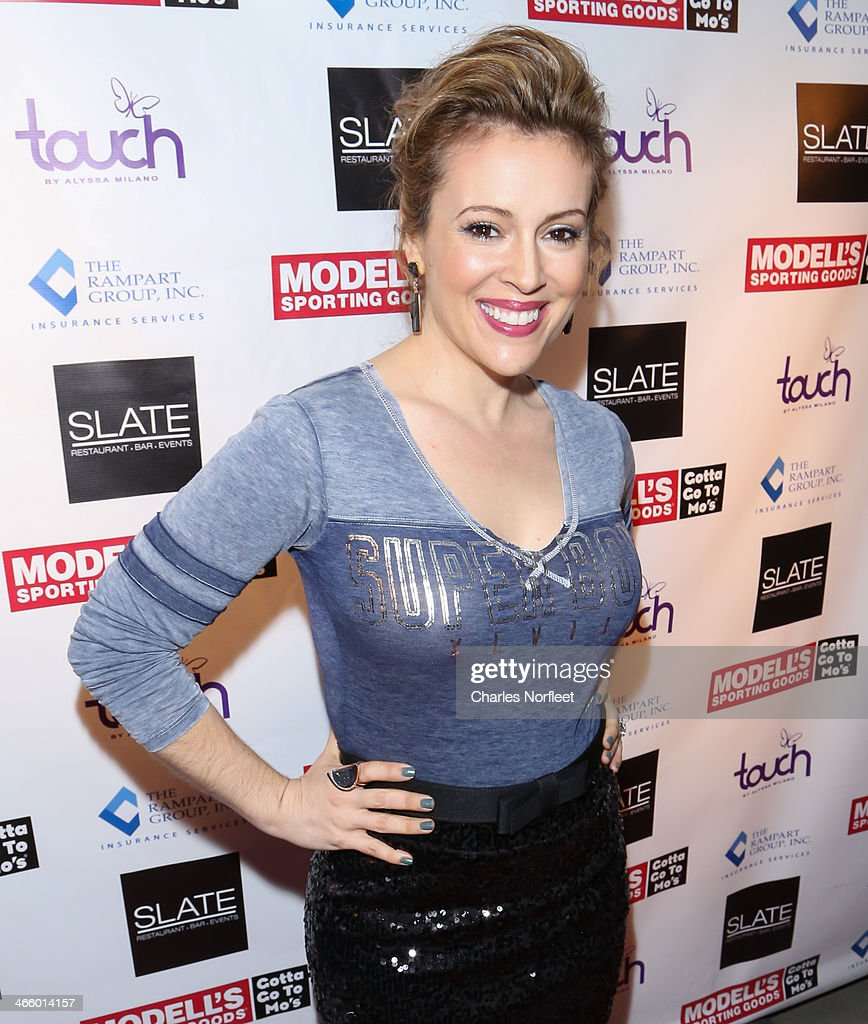 Actress <a gi-track='captionPersonalityLinkClicked' href=/galleries/search?phrase=Alyssa+Milano&family=editorial&specificpeople=203329 ng-click='$event.stopPropagation()'>Alyssa Milano</a> attends Modell's Super Bowl Kickoff Party & Touch By <a gi-track='captionPersonalityLinkClicked' href=/galleries/search?phrase=Alyssa+Milano&family=editorial&specificpeople=203329 ng-click='$event.stopPropagation()'>Alyssa Milano</a> Fashion Show at Slate on January 30, 2014 in New York City.