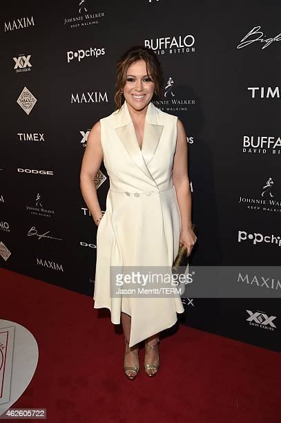 Actress Alyssa Milano attends the Maxim Party with Johnnie Walker Timex Dodge Hugo Boss Dos Equis Buffalo Jeans Tabasco and popchips on January 31...