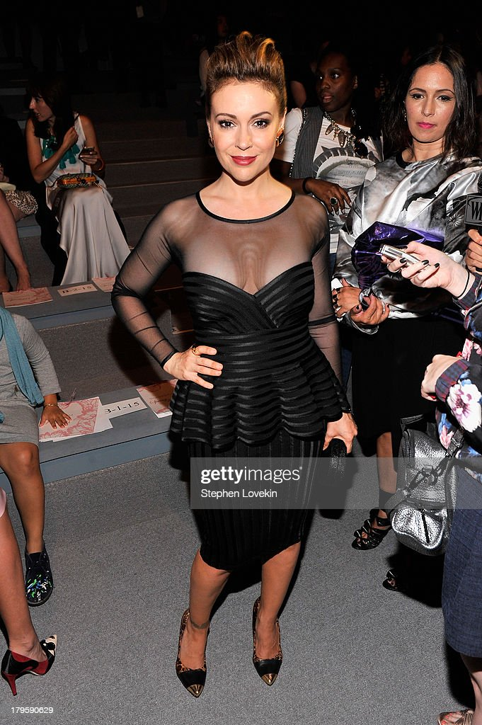 Actress Alyssa Milano attends the Tadashi Shoji Spring 2014 fashion show during Mercedes-Benz Fashion Week at The Stage at Lincoln Center on September 5, 2013 in New York City.