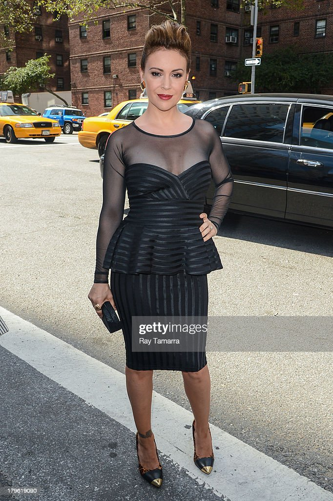 Actress <a gi-track='captionPersonalityLinkClicked' href=/galleries/search?phrase=Alyssa+Milano&family=editorial&specificpeople=203329 ng-click='$event.stopPropagation()'>Alyssa Milano</a> enters Mercedes-Benz Fashion Week at Lincoln Center on September 5, 2013 in New York City.