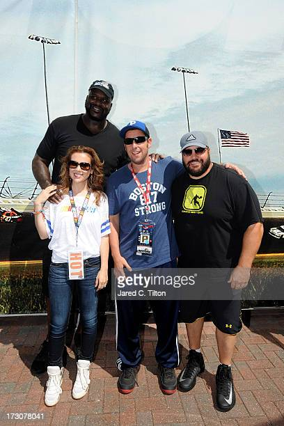 Actress Alyssa Milano former NBA player Shaquille O'Neal actor Adam Sandler and actor Kevin James pose for a photo prior to the NASCAR Sprint Cup...