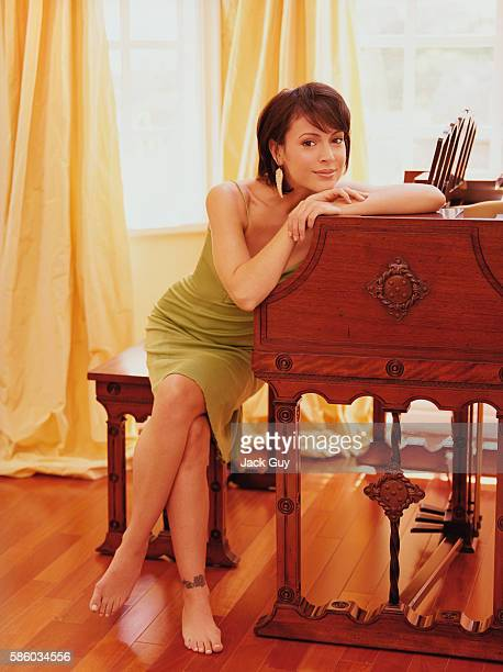 Actress Alyssa Milano is photographed for InStyle Magazine in 2004 at home in California PUBLISHED IMAGE