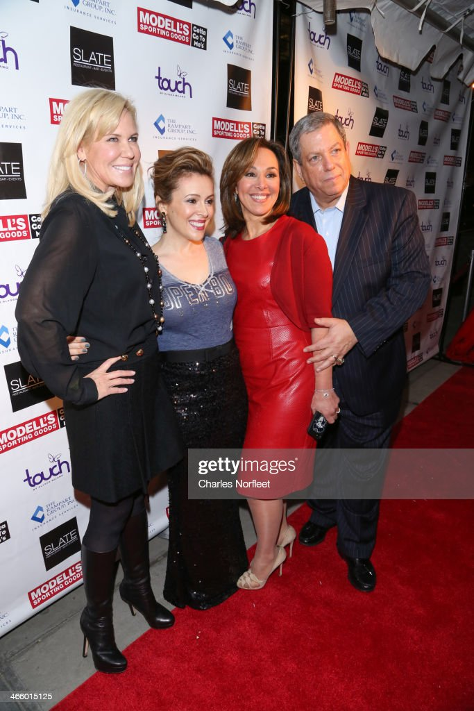 Actress <a gi-track='captionPersonalityLinkClicked' href=/galleries/search?phrase=Alyssa+Milano&family=editorial&specificpeople=203329 ng-click='$event.stopPropagation()'>Alyssa Milano</a> (2nd from left), news anchor <a gi-track='captionPersonalityLinkClicked' href=/galleries/search?phrase=Rosanna+Scotto&family=editorial&specificpeople=704122 ng-click='$event.stopPropagation()'>Rosanna Scotto</a>, and Modell's CEO Mitchell Modell attend Modell's Super Bowl Kickoff Party & Touch By <a gi-track='captionPersonalityLinkClicked' href=/galleries/search?phrase=Alyssa+Milano&family=editorial&specificpeople=203329 ng-click='$event.stopPropagation()'>Alyssa Milano</a> Fashion Show at Slate on January 30, 2014 in New York City.