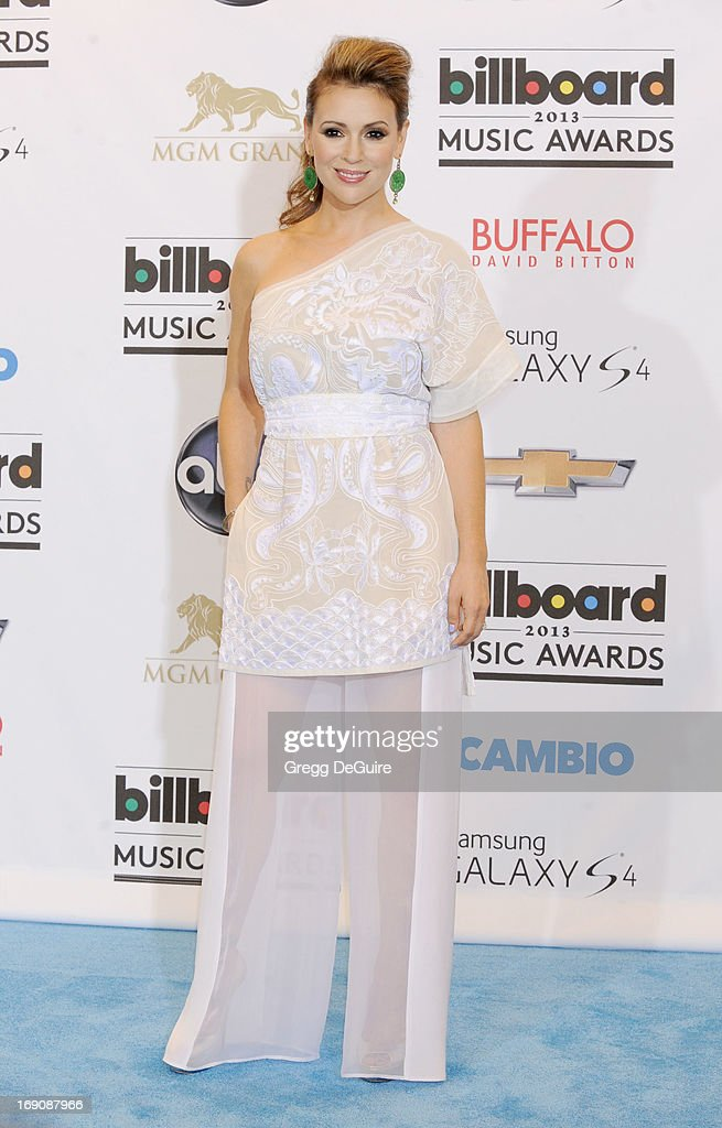 Actress Alyssa Milano poses in the press room at the 2013 Billboard Music Awards at MGM Grand Garden Arena on May 19, 2013 in Las Vegas, Nevada.