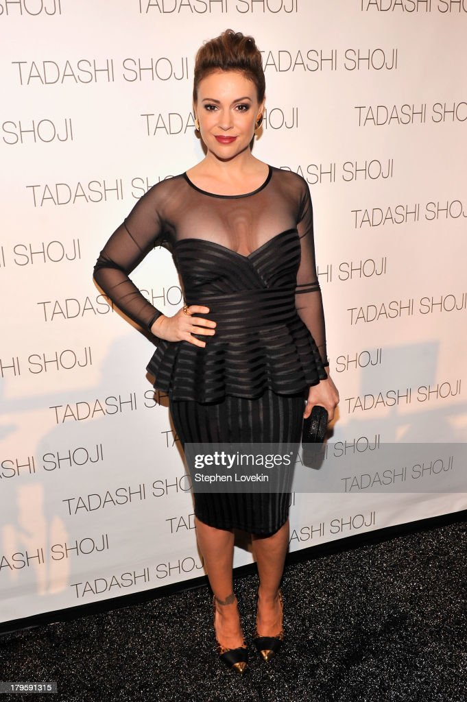 Actress Alyssa Milano prepares backstage at the Tadashi Shoji Spring 2014 fashion show during Mercedes-Benz Fashion Week at The Stage at Lincoln Center on September 5, 2013 in New York City.