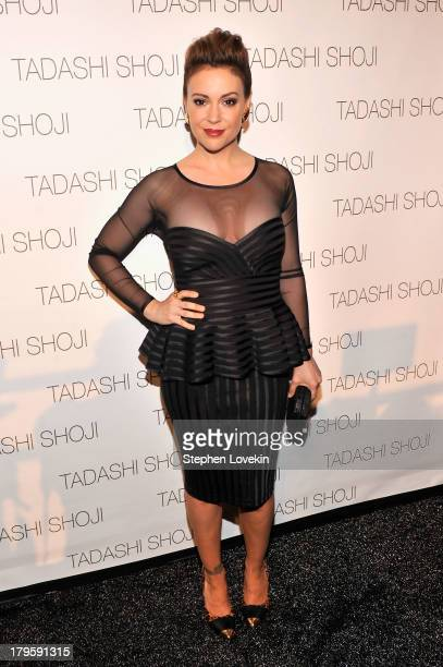 Actress Alyssa Milano prepares backstage at the Tadashi Shoji Spring 2014 fashion show during MercedesBenz Fashion Week at The Stage at Lincoln...