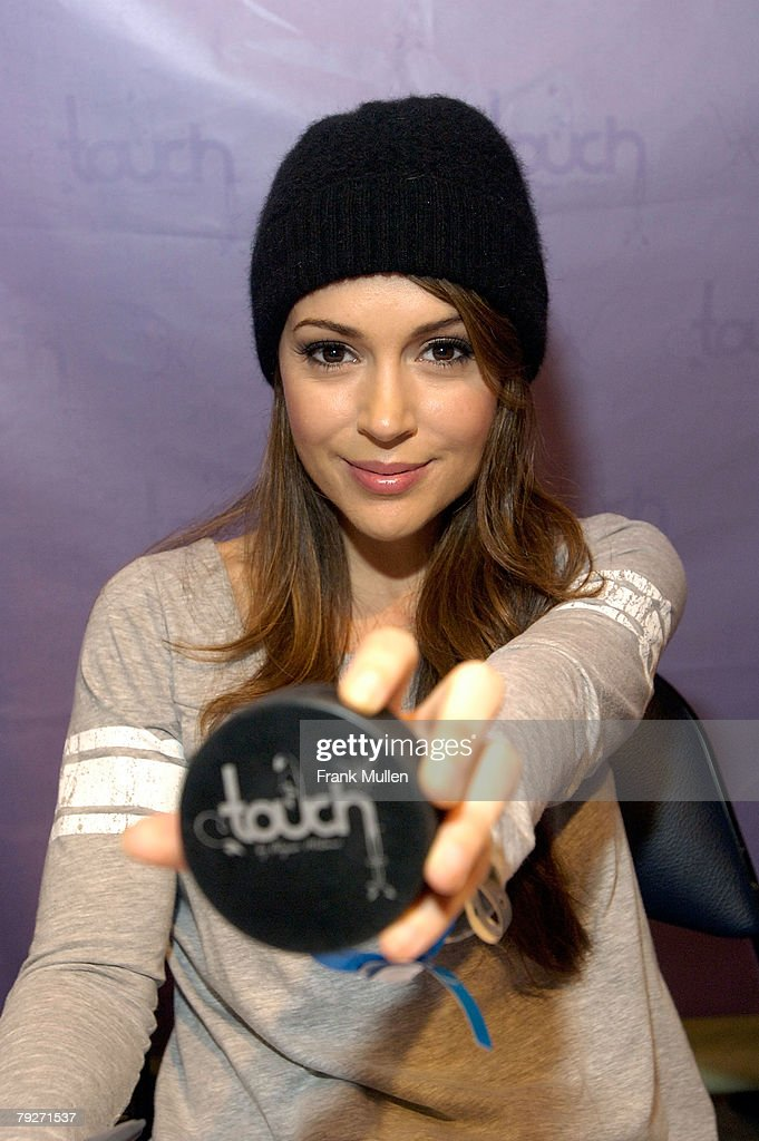 Actress Alyssa Milano signs autographs to promote her 'Touch' clothing line as part of the NHL All Star Game weekend at Philips Arena on January 26...