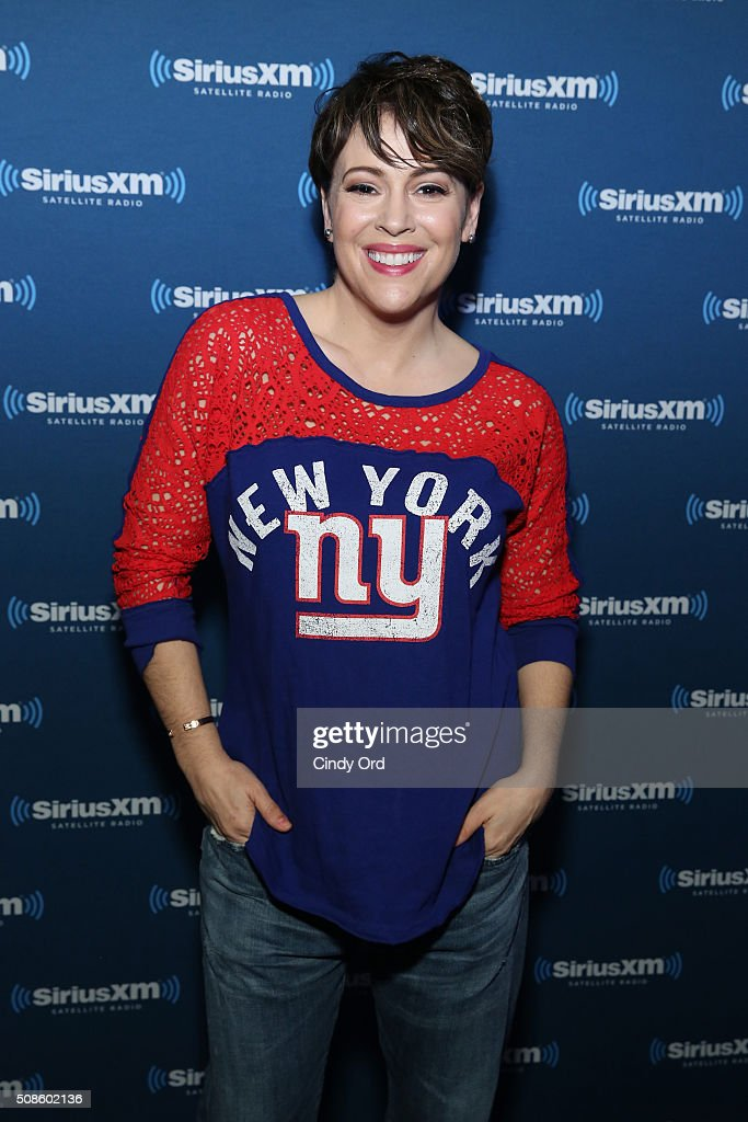 Actress Alyssa Milano visits the SiriusXM set at Super Bowl 50 Radio Row at the Moscone Center on February 5 2016 in San Francisco California
