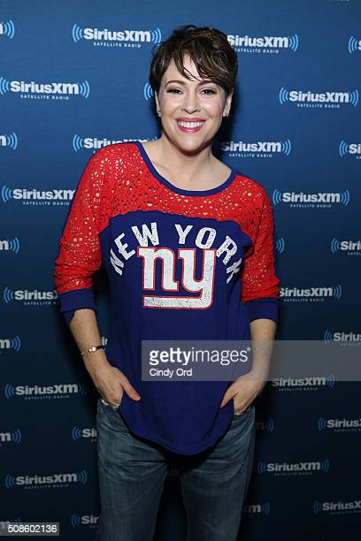 Actress Alyssa Milano visits the SiriusXM set at Super Bowl 50 Radio Row at the Moscone Center on February 5 2016 in San Francisco California