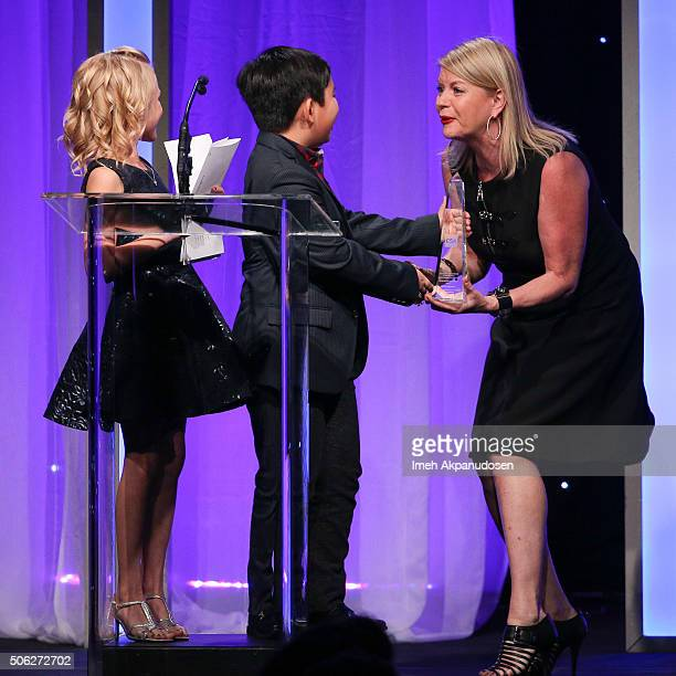 Actress Alyvia Alyn Lind and actor Albert Tsai present an award to casting director Julie AshtonBarson onstage during the Casting Society Of...