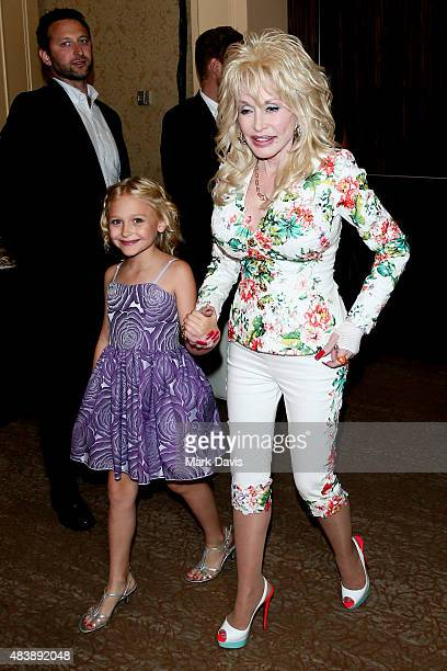 Actress Alyvia Alyn Lind and singer Dolly Parton arrive at the NBCUniversal 2015 Summer Press Tour at the Beverly Hilton on August 13 2015 in Beverly...