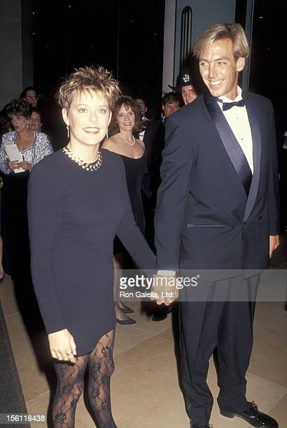 Actress Amanda Bearse and date attending 48th Annual Golden Globe Awards on January 19 1991 at the Beverly Hilton Hotel in Beverly Hills California