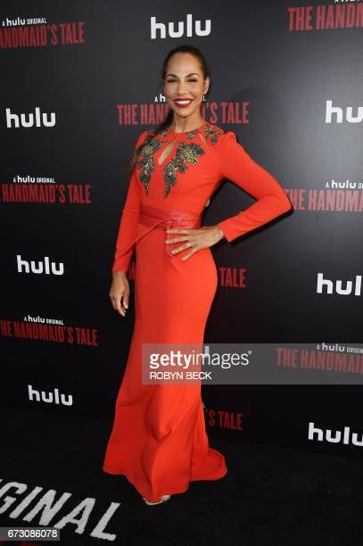 Actress Amanda Brugel attends the Los Angeles premiere of Hulus 'The Handmaids Tale' April 25 2017 at the ArcLight Dome in Hollywood California / AFP...