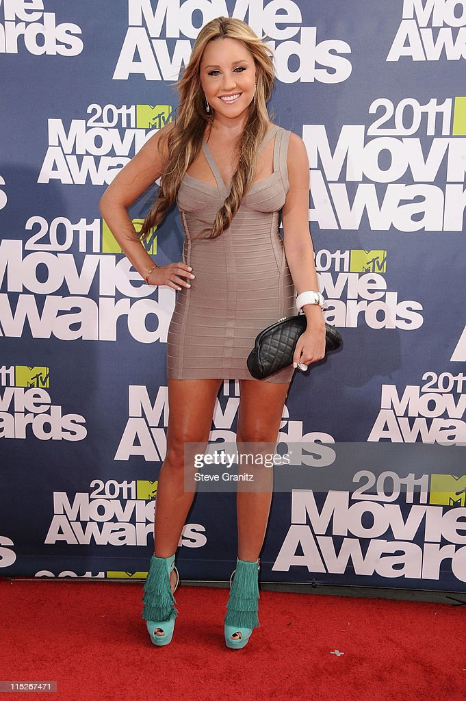 Actress <a gi-track='captionPersonalityLinkClicked' href=/galleries/search?phrase=Amanda+Bynes&family=editorial&specificpeople=201660 ng-click='$event.stopPropagation()'>Amanda Bynes</a> arrives at the 2011 MTV Movie Awards at Universal Studios' Gibson Amphitheatre on June 5, 2011 in Universal City, California.