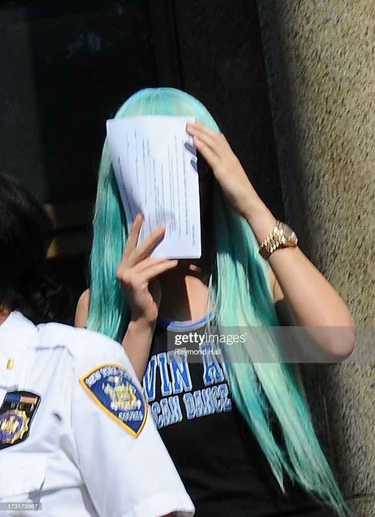 Actress Amanda Bynes attends an appearance at Manhattan Criminal Court on July 9, 2013 in New York City. Bynes is facing charges of reckless endangerment, tampering with evidence and criminal possession of marijuana in relation to her arrest on May 23, 2013.