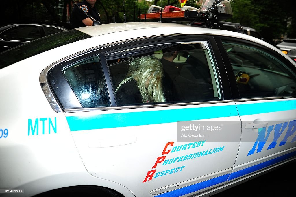 Actress Amanda Bynes departs Manhattan Central Booking after being arrested on May 23 for alleged charges of reckless endangerment, tampering with evidence and criminal possession of marijuana at Manhattan Criminal Court on May 24, 2013 in New York City.