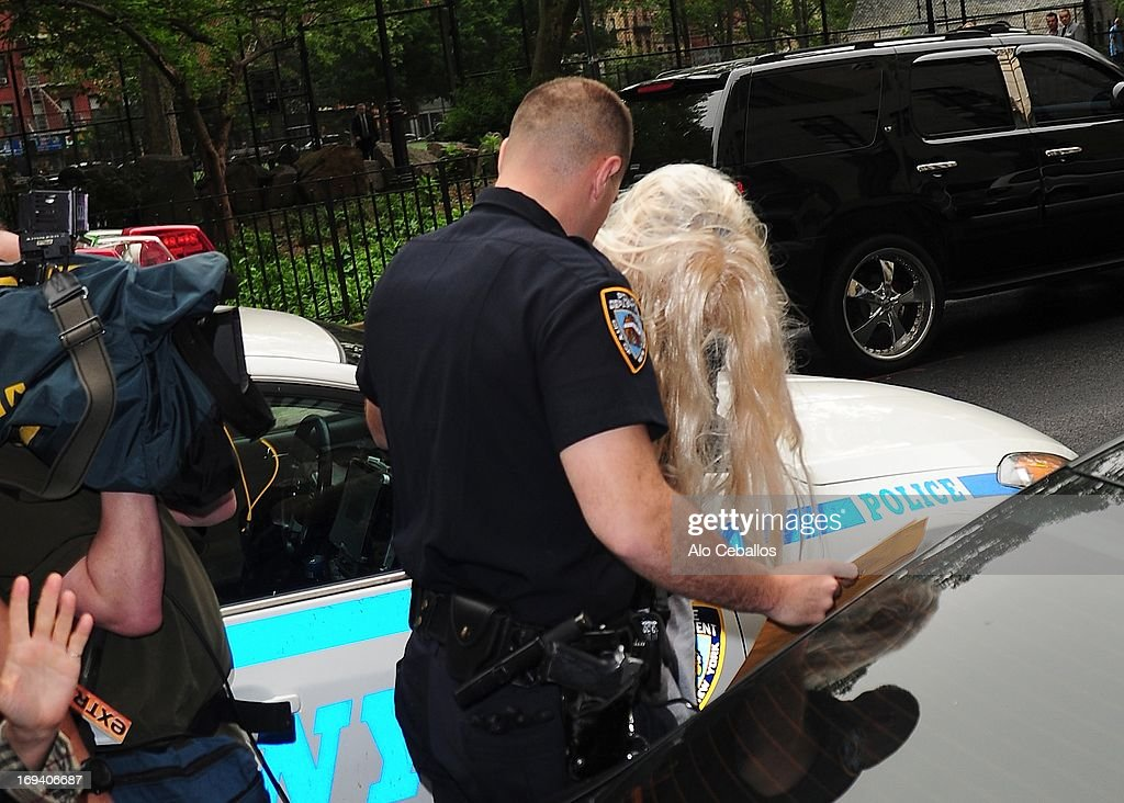 Actress <a gi-track='captionPersonalityLinkClicked' href=/galleries/search?phrase=Amanda+Bynes&family=editorial&specificpeople=201660 ng-click='$event.stopPropagation()'>Amanda Bynes</a> departs Manhattan Central Booking after being arrested on May 23 2013 for alleged charges of reckless endangerment, tampering with evidence and criminal possession of marijuana at Manhattan Criminal Court on May 24, 2013 in New York City.