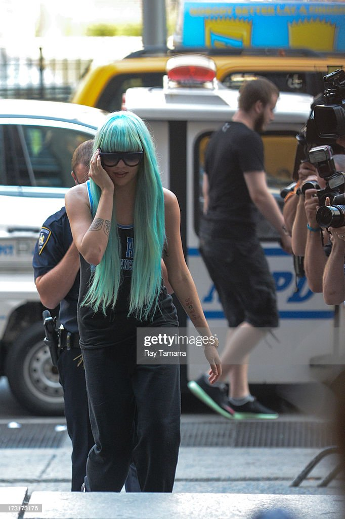 Actress Amanda Bynes enters Manhattan Criminal Court on July 9, 2013 in New York City. Bynes is facing charges of reckless endangerment, tampering with evidence and criminal possession of marijuana in relation to her arrest on May 23, 2013.