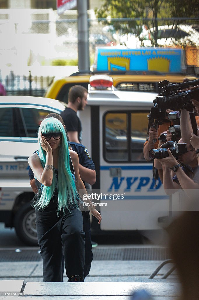 Actress <a gi-track='captionPersonalityLinkClicked' href=/galleries/search?phrase=Amanda+Bynes&family=editorial&specificpeople=201660 ng-click='$event.stopPropagation()'>Amanda Bynes</a> enters Manhattan Criminal Court on July 9, 2013 in New York City. Bynes is facing charges of reckless endangerment, tampering with evidence and criminal possession of marijuana in relation to her arrest on May 23, 2013.