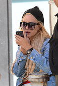 Actress Amanda Bynes is seen doing her makeup outside in Soho on October 6 2014 in New York City