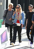Actress Amanda Bynes is seen taking photos with funs outside the apple store and doing her make up on the street in Soho on October 6 2014 in New...