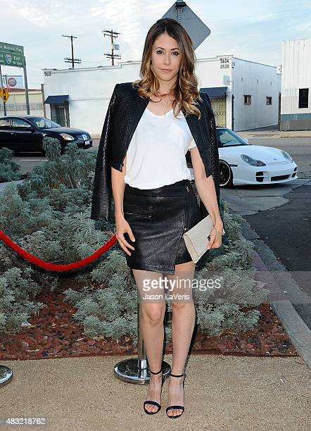 Actress Amanda Crew attends the BCBG Max Azria Resort 2016 collections at Samuel Freeman Gallery on August 6 2015 in Los Angeles California