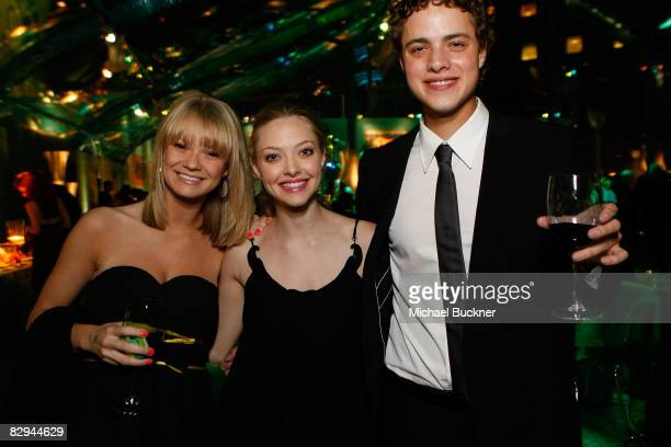 Actress Amanda Heard actress Amanda Seyfried and actor Douglas Smith attends the HBO EMMY Party at the Plaza at the Pacific Design Center on...