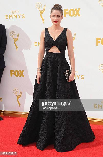 Actress Amanda Peet arrives at the 67th Annual Primetime Emmy Awards at Microsoft Theater on September 20 2015 in Los Angeles California