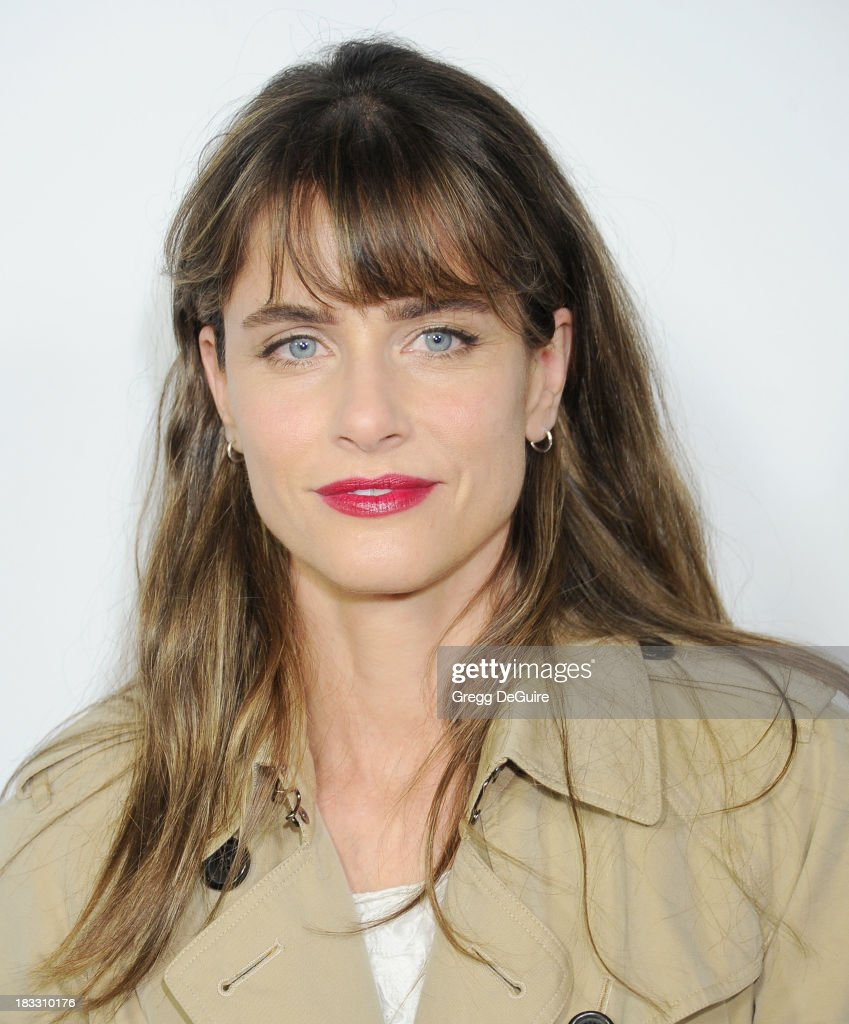 Actress <a gi-track='captionPersonalityLinkClicked' href=/galleries/search?phrase=Amanda+Peet&family=editorial&specificpeople=201910 ng-click='$event.stopPropagation()'>Amanda Peet</a> arrives at the Los Angeles premiere of FX's 'American Horror Story: Coven' at Pacific Design Center on October 5, 2013 in West Hollywood, California.