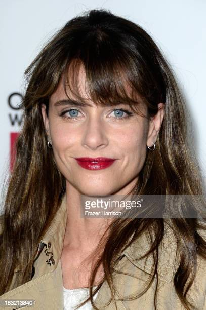 Actress Amanda Peet arrives at the premiere of FX's 'American Horror Story Coven' at Pacific Design Center on October 5 2013 in West Hollywood...