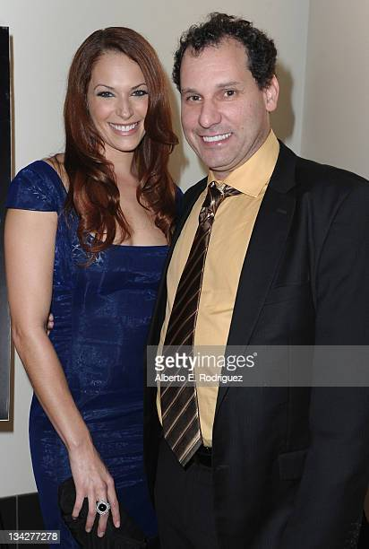 Actress Amanda Righetti and director Jordan Alan arrive to a screening of 'Cats Dancing On Jupiter' at ArcLight Cinemas on November 29 2011 in...