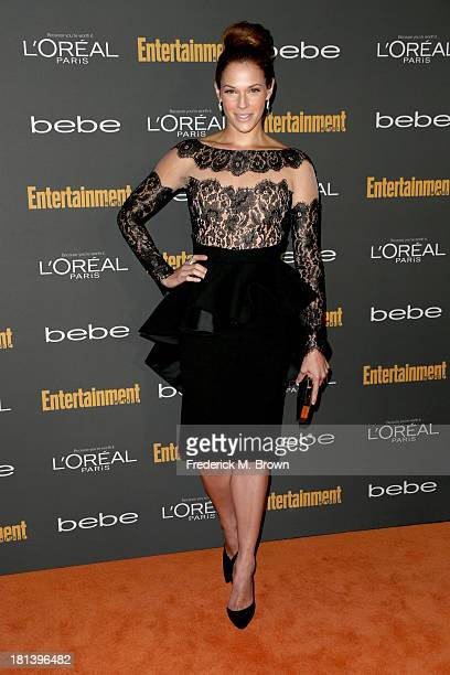 Actress Amanda Righetti arrives at Entertainment Weekly's PreEmmy Party at Fig Olive Melrose Place on September 20 2013 in West Hollywood California
