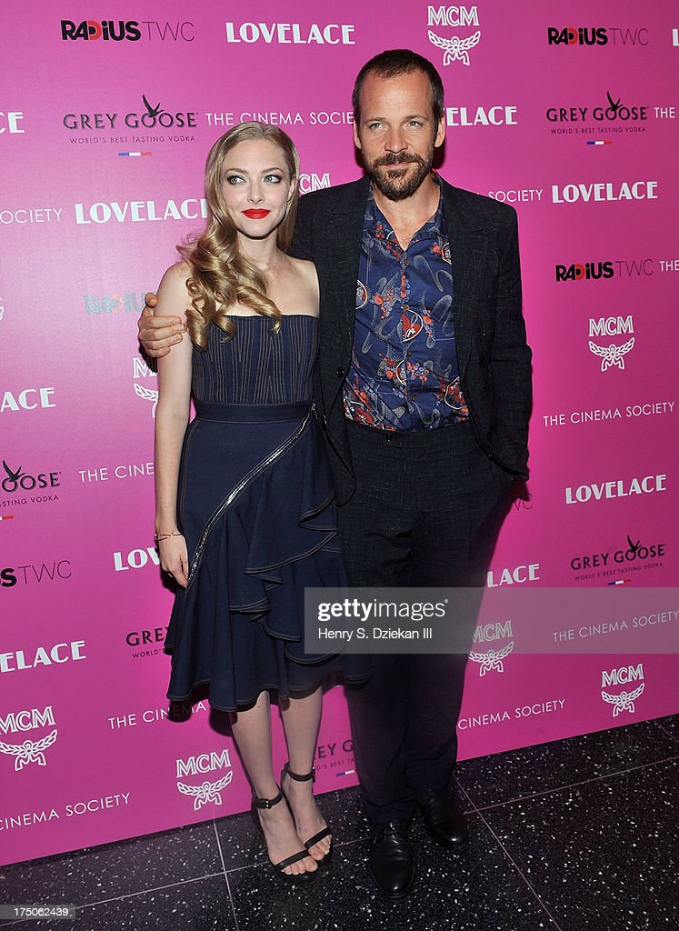 Actress Amanda Seyfried and actor Peter Sarsgaard attend The Cinema Society and MCM with Grey Goose screening of Radius TWC's 'Lovelace' at Museum of Modern Art on July 30, 2013 in New York City.