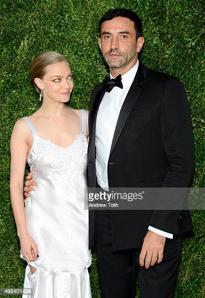 Actress Amanda Seyfried and designer and keynote speaker Riccardo Tisci attend the 12th annual CFDA/Vogue Fashion Fund Awards at Spring Studios on...