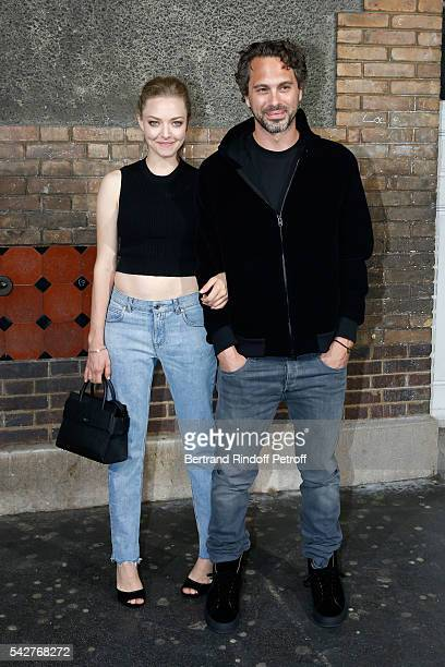 Actress Amanda Seyfried and her companion Thomas Sadoski attend the Givenchy Menswear Spring/Summer 2017 show as part of Paris Fashion Week on June...