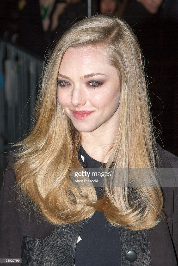 Actress Amanda Seyfried arrives to attend the 'Givenchy' Fall/Winter 2013 Ready-to-Wear show as part of Paris Fashion Week on March 3, 2013 in Paris, France.