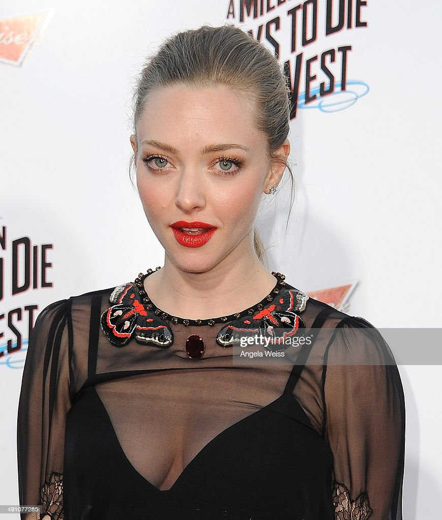 Actress <a gi-track='captionPersonalityLinkClicked' href=/galleries/search?phrase=Amanda+Seyfried&family=editorial&specificpeople=216619 ng-click='$event.stopPropagation()'>Amanda Seyfried</a> attends the premiere of 'A Million Ways To Die In The West' presented by Budweiser at Regency Village Theatre on May 15, 2014 in Los Angeles, California.