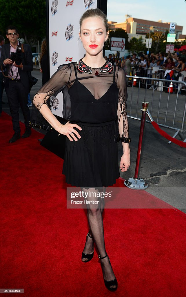 Actress <a gi-track='captionPersonalityLinkClicked' href=/galleries/search?phrase=Amanda+Seyfried&family=editorial&specificpeople=216619 ng-click='$event.stopPropagation()'>Amanda Seyfried</a> attends the premiere of Universal Pictures and MRC's 'A Million Ways To Die In The West' at Regency Village Theatre on May 15, 2014 in Westwood, California.