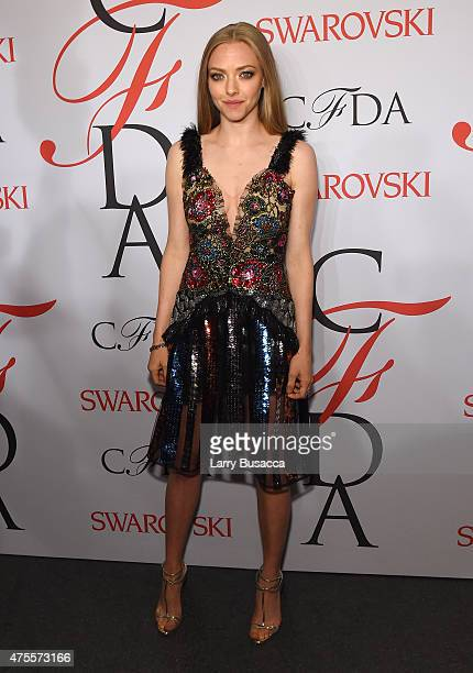 Actress Amanda Seyfried poses on the winners walk at the 2015 CFDA Fashion Awards at Alice Tully Hall at Lincoln Center on June 1 2015 in New York...