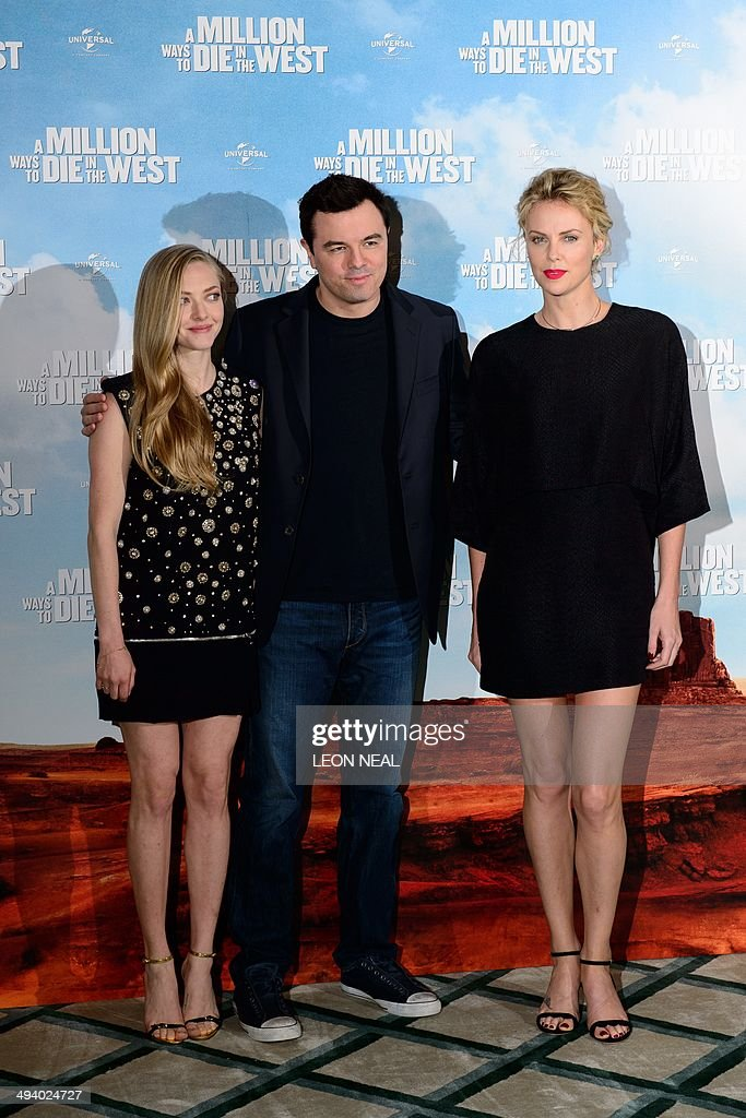 US actress Amanda Seyfried (L), US actor Seth MacFarlane and South African actress Charlize Theron pose for photographers during a photo call for their latest film 'A Million Ways To Die In The West' at Claridges, central London, on May 27, 2014. Starring Seth MacFarlane, Liam Neeson, Amanda Seyfried and Charlize Theron, the film is about a man in America's Wild West who has struggles to regain his courage after backing out of a gunfight.