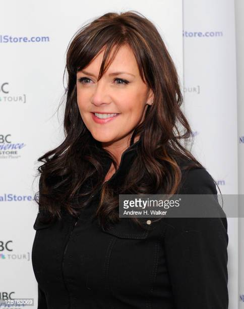 Actress Amanda Tapping poses for photos before greeting fans at the NBC Experience Store on October 7 2011 in New York City