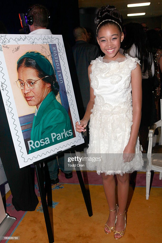 Actress Amandla Stenberg previews the Rosa Parks Forever Stamp in the U.S. Postal Service Civil Rights Stamp Gallery backstage at the NAACP Image Awards on February 1, 2013 at The Shrine Auditorium.