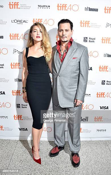 Actress Amber Heard and actor Johnny Depp attend the 'Black Mass' premiere during the 2015 Toronto International Film Festival at The Elgin on...
